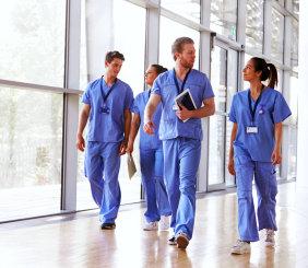 group of nurses walking on the hallway inside the hospital