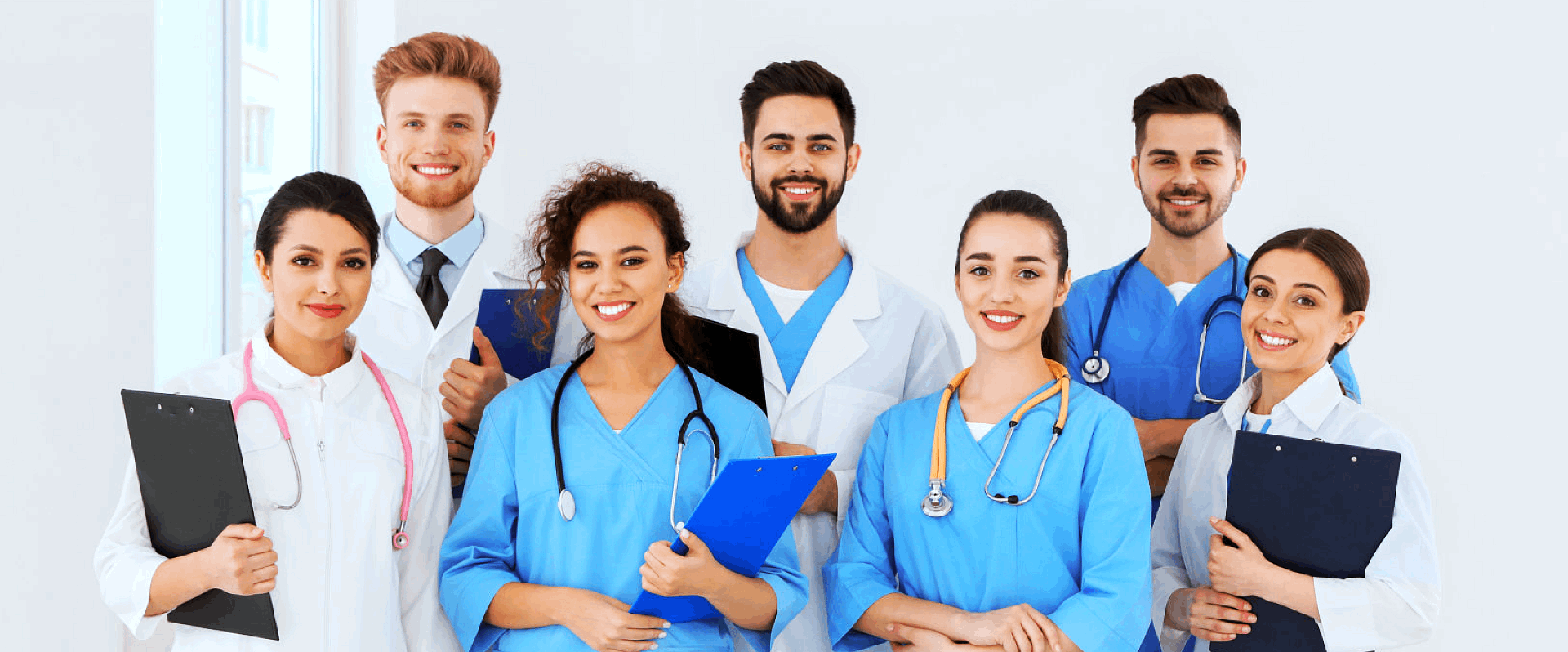 group of medical staffs, each holding a log book